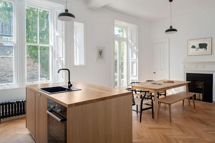 Luke McClelland opened up the tiny, old kitchen to the dining room to create one airy space. ZAC and ZAC