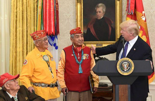 PHOTO: President Donald Trump speaks with Navajo Code Talkers during a meeting in the Oval Office of the White House in Washington, Nov. 27, 2017. A painting of President Andrew Jackson, who signed the Indian Removal Act in 1830, is seen in the foreground (Susan Walsh/AP)