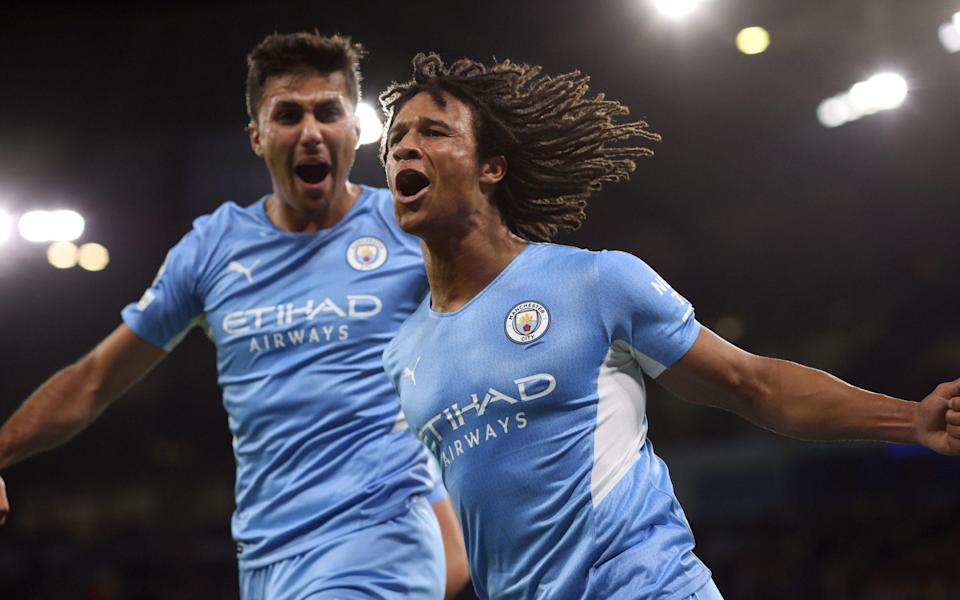 Nathan Ake of Man City celebrates the opening goal with Rodrigo during the UEFA Champions League group A match between Manchester City and RB Leipzig - Charlotte Wilson/Offside via Getty Images