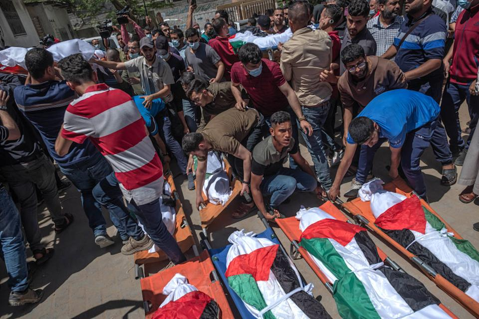 Palestinians take part in the funeral of the Abu Hatab family in Gaza City, Gaza.