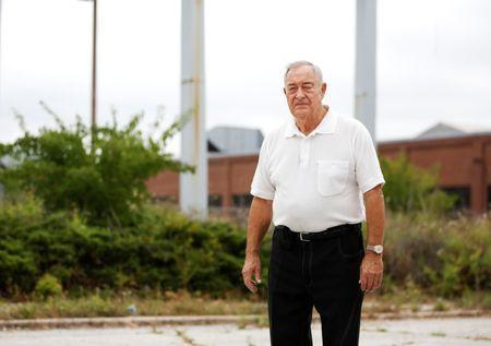Gerald Poor stands in front of the now shuttered BorgWarner factory, where he worked for over 40 years, in Muncie, Indiana, U.S., August 13, 2016. REUTERS/Chris Bergin