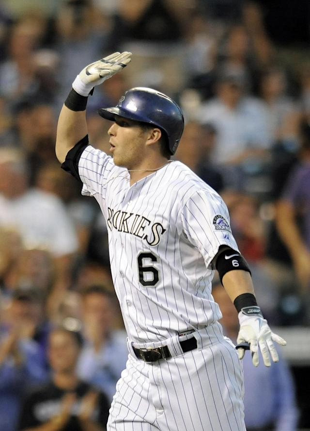 Colorado Rockies Corey Dickerson celebrates after hitting a solo home run in the fifth inning of a baseball game against the Washington Nationals on Tuesday, July 22, 2014, in Denver. (AP Photo/Chris Schneider)