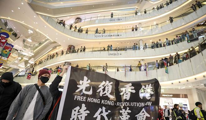 Anti-government protesters march through Moko shopping centre in Mong Kok on Boxing Day. Photo: Nora Tam