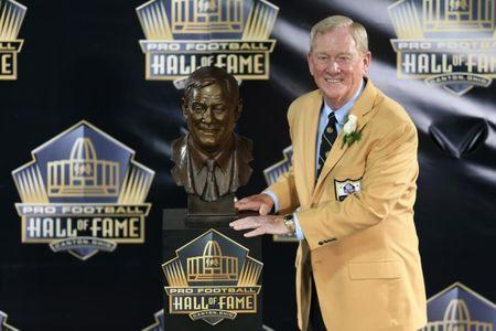 Aug 8, 2015, Canton, OH, USA; Bill Polian poses with his bust at the 2015 Pro Football Enshrinement Cermony at Tom Benson Hall of Fame Stadium. Mandatory Credit: Andrew Weber-USA TODAY Sports