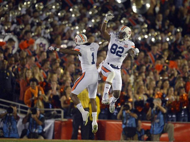 Auburn's Melvin Ray is congratulated by teammate Trovon Reed (1) after catching a touchdown pass during the first half of the NCAA BCS National Championship college football game against Florida State Monday, Jan. 6, 2014, in Pasadena, Calif. (AP Photo/Mark J. Terrill)