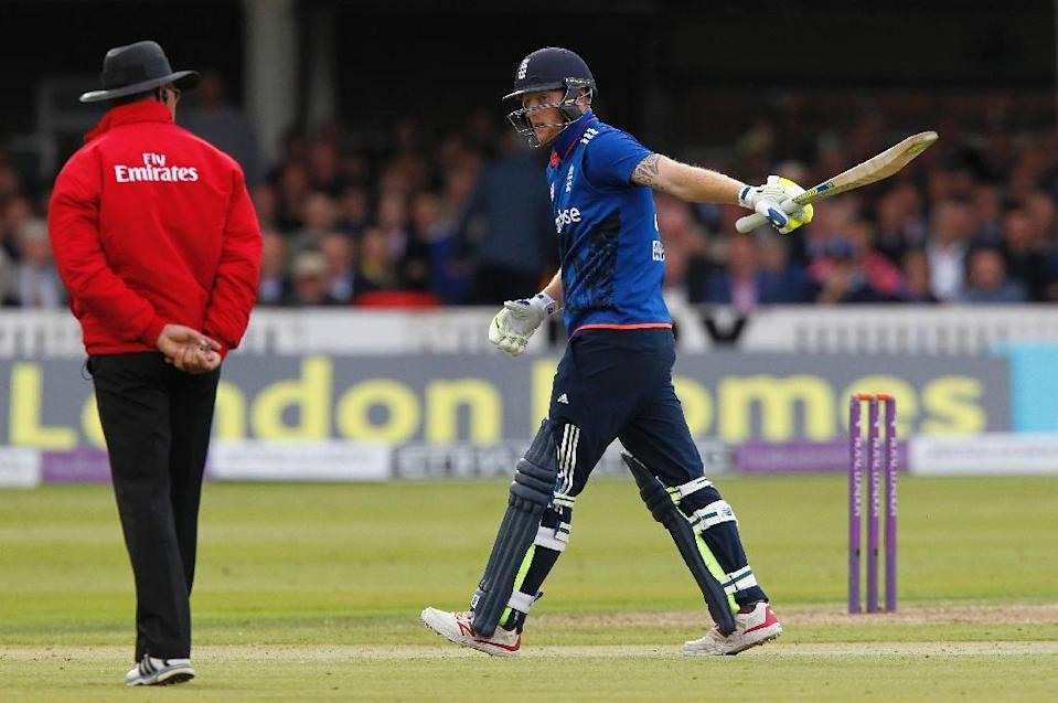 """England's Ben Stokes walks back to the pavilion after losing his wicket for """"obstructing the field"""" during the second one-day international (ODI) against Australia at Lord's on September 5, 2015 (AFP Photo/Ian Kington)"""