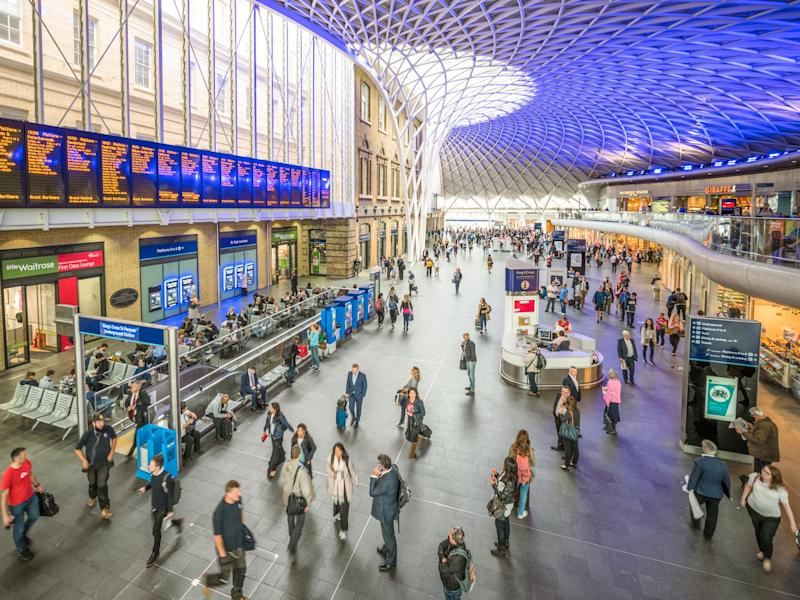 High angle view of passengers in the main hall of King's Cross Train Station, one of Central London's busiest stations: Getty