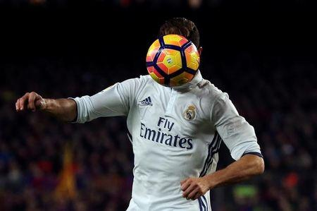"Football Soccer - Barcelona v Real Madrid - Spanish La Liga Santander - Nou Camp stadium, Barcelona, Spain - 3/12/16 Real Madrid's Cristiano Ronaldo in action during the ""Clasico"". REUTERS/Sergio Perez"