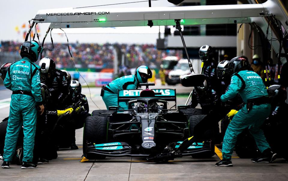 Lewis Hamilton of Great Britain driving the (44) Mercedes AMG Petronas F1 Team Mercedes W12 makes a pitstop during the F1 Grand Prix of Turkey at Intercity Istanbul Park on October 10, 2021 in Istanbul, Turkey - Getty Images Sport