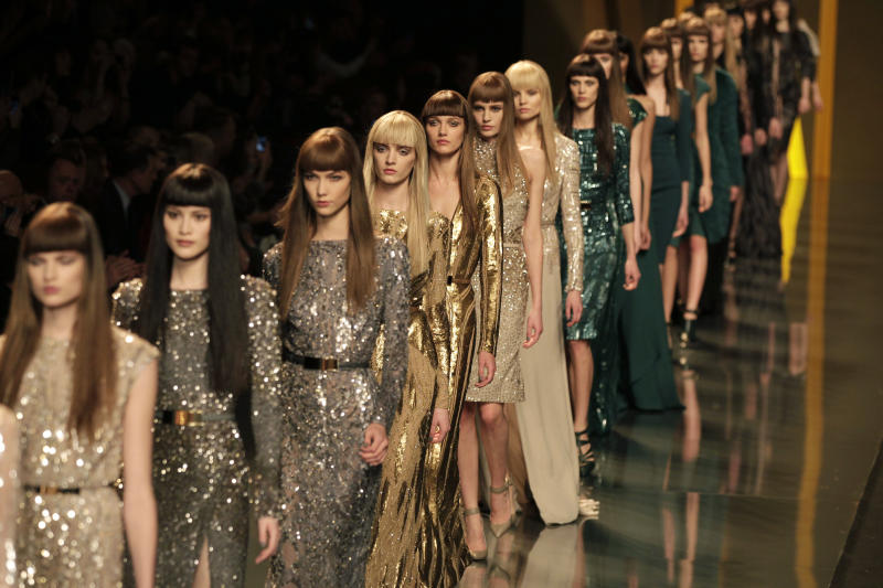 Models present creations b Lebanese designer Elie Saab as part of his Women's Fall-Winter, ready-to-wear 2013 fashion collection, during the Paris Fashion week, Wednesday, March 7, 2012. (AP Photo/Michel Euler)