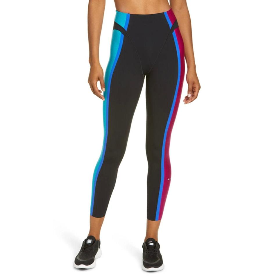 """Of course, if you need something for actually working out, Nike's sweat-wicking <a href=""""https://www.glamour.com/gallery/best-black-leggings-to-buy-now?mbid=synd_yahoo_rss"""" rel=""""nofollow noopener"""" target=""""_blank"""" data-ylk=""""slk:leggings"""" class=""""link rapid-noclick-resp"""">leggings</a> are a solid bet. The electric-colored side panels and front seams also give it a cool, retro feel. $165, Nordstrom. <a href=""""https://www.nordstrom.com/s/nike-7-8-training-tights/5539089?"""" rel=""""nofollow noopener"""" target=""""_blank"""" data-ylk=""""slk:Get it now!"""" class=""""link rapid-noclick-resp"""">Get it now!</a>"""
