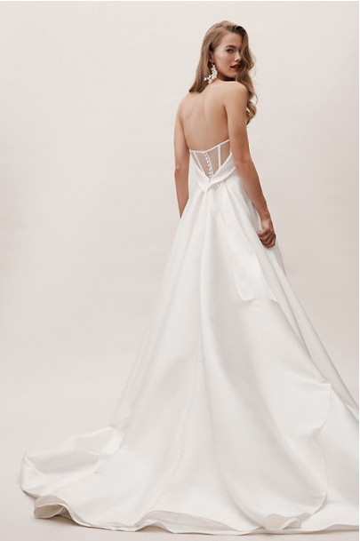 "<p>If you're happy to buy online and keep your fingers crossed it fits, <a href=""http://www.bhldn.com/shop-the-bride-wedding-dresses?filter=&sortType=priceAsc"" rel=""nofollow noopener"" target=""_blank"" data-ylk=""slk:BHLDN's"" class=""link rapid-noclick-resp"">BHLDN's</a> wedding dresses could well be worth the risk. Starting at $160 - yes, I'm afraid this is a US brand but they do ship to the UK - styles include tulle skirts, lace bodies and full-blown bridal gowns.</p><p>Carrington gown £845 <a class=""link rapid-noclick-resp"" href=""https://go.redirectingat.com?id=127X1599956&url=https%3A%2F%2Fwww.bhldn.com%2Fproducts%2Fcarrington-gown%3Fvia%3DZ2lkOi8vdXJibi9Xb3JrYXJlYTo6Q2F0YWxvZzo6Q2F0ZWdvcnkvQ0E3MjA3QjY&sref=http%3A%2F%2Fwww.cosmopolitan.com%2Fuk%2Ffashion%2Fstyle%2Fg4924%2Fhigh-street-brands-that-sell-wedding-dresses%2F"" rel=""nofollow noopener"" target=""_blank"" data-ylk=""slk:BUY NOW"">BUY NOW</a></p>"