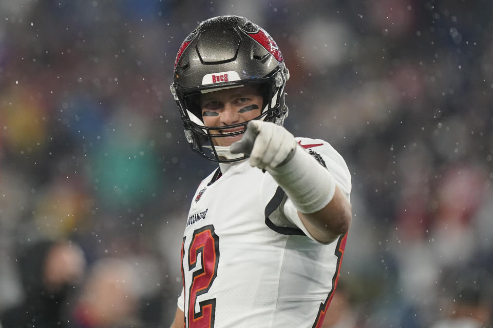 Tampa Bay Buccaneers quarterback Tom Brady (12) points toward the sidelines prior to an NFL football game between the New England Patriots and Tampa Bay Buccaneers, Sunday, Oct. 3, 2021, in Foxborough, Mass. (AP Photo/Steven Senne)