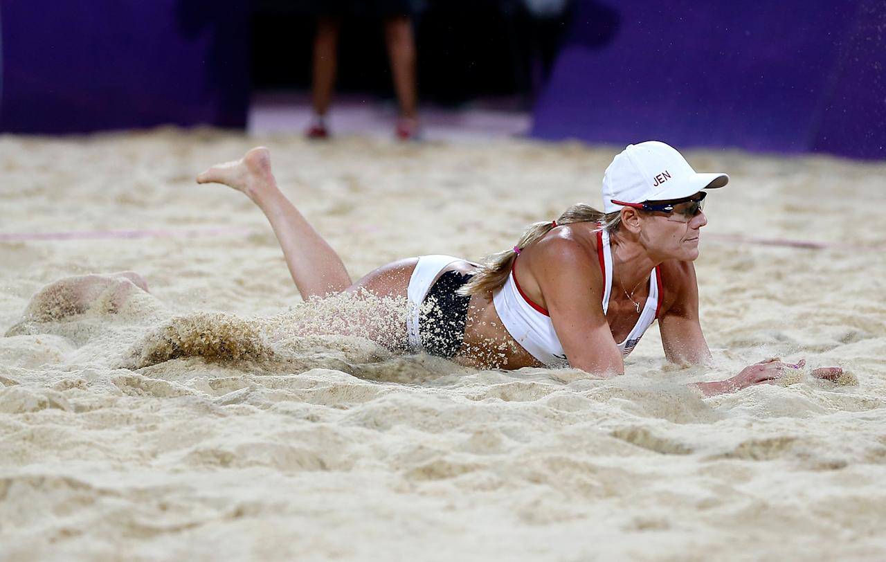 LONDON, ENGLAND - AUGUST 08:  Jennifer Kessy of the United States dives for the ball in the Women's Beach Volleyball Gold medal match on Day 12 of the London 2012 Olympic Games at the Horse Guard's Parade on August 8, 2012 in London, England.  (Photo by Jamie Squire/Getty Images)