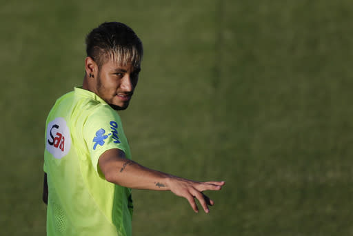 Brazil's Neymar gestures during a training session in Fortaleza, Brazil, Thursday, July 3, 2014. Brazil will face Colombia on Friday in a quarterfinal soccer match at the World Cup. (AP Photo/Felipe Dana)