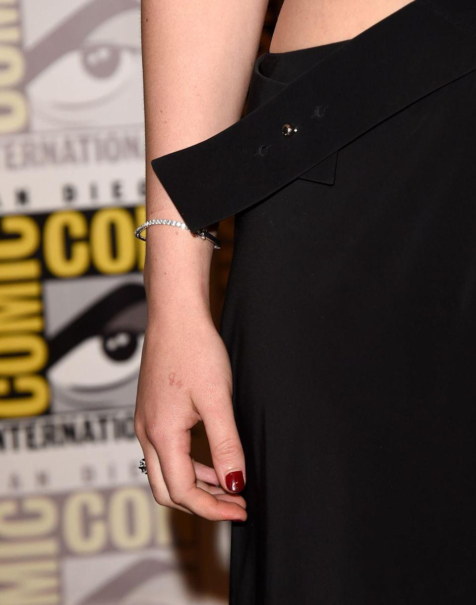 """<p>While it is faint, if you look closely at Jennifer Lawrence's right hand, in light reddish-brown ink is H20. Yes, the chemical formula for water, and yes, the Oscar winner knows that the tat is actually written incorrectly. At a Comic-Con panel in 2015 J Law explained that she was hanging out with Liam Hemsworth's family and they were all getting tattoos and she decided she should as well.</p><p>""""I was like, 'Well I'm always gonna need to be hydrated, so I guess I should just get H2O on my hand,'"""" she said, <em><a href=""""https://www.vogue.co.uk/article/jennifer-lawrence-h20-tattoo-disaster"""" rel=""""nofollow noopener"""" target=""""_blank"""" data-ylk=""""slk:Vogue"""" class=""""link rapid-noclick-resp"""">Vogue</a></em> reports. However, the <em>Passengers</em> star realized afterward that the """"2"""" in the design is too high and admitted,""""I should have Googled it before I got it tattooed on my body forever.""""</p>"""