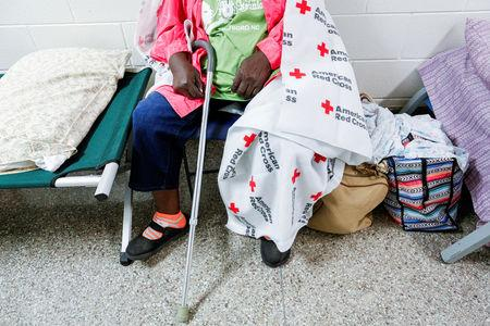 A woman sits in a shelter run by Red Cross before Hurricane Florence comes ashore in Grantsboro, North Carolina, September 13, 2018. REUTERS/Eduardo Munoz
