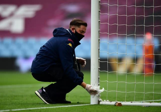 Goal posts are wiped clean with a disinfectant wipe ahead of the match at Villa Park (Shaun Botterill/NMC Pool/PA)