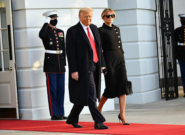 <p>The Trumps walk out of the White House together shortly after 8 a.m. local time on Jan. 20, 2021.</p>
