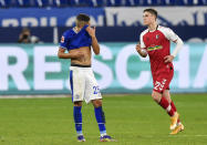 Schalke's Amine Harit, left, reacts after Freiburg's Roland Sallai, right, scored the second goal during the German Bundesliga soccer match between FC Schalke 04 and SC Freiburg at the Arena in Gelsenkirchen, Germany, Wednesday, Dec. 16, 2020. (AP Photo/Martin Meissner, Pool)