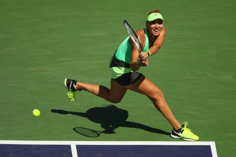 Elena Vesnina of Russia plays a backhand against Svetlana Kuznetsova of Russia on March 19, 2017 in Indian Wells, California