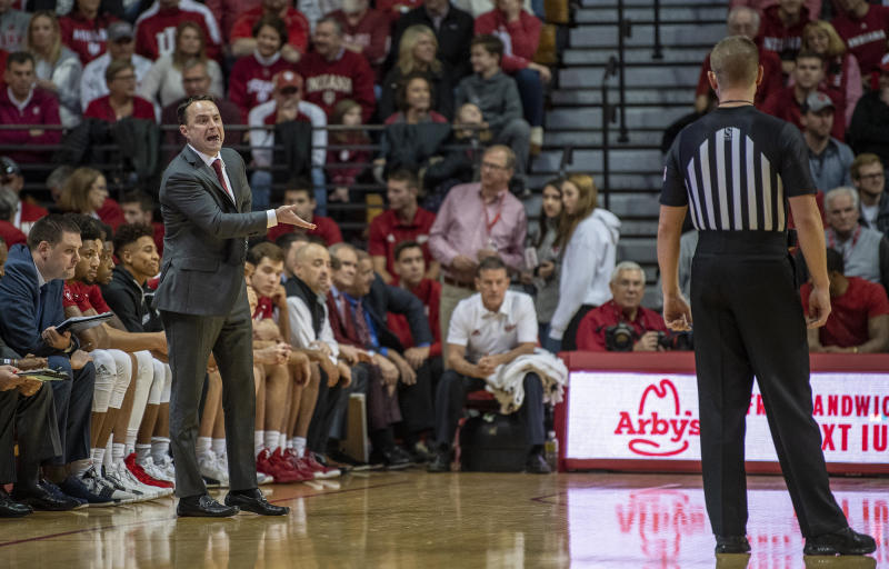 Indiana's head coach Archie Miller, left talks with an official, right, during an NCAA college basketball game against Troy in Bloomington, Ind., Saturday, Nov. 16, 2019. (Rich Janzaruk/The Herald-Times via AP)
