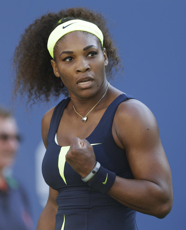 Serena Williams reacts while playing against Victoria Azarenka, of Belarus, during the championship match at the 2012 US Open tennis tournament, Sunday, Sept. 9, 2012, in New York. (AP Photo/Darron Cummings)