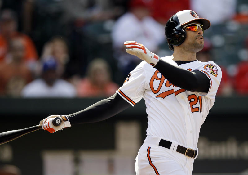 Baltimore Orioles' Nick Markakis watches his solo home run in the first inning of the first baseball game of a doubleheader against the Texas Rangers in Baltimore, Thursday, May 10, 2012. (AP Photo/Patrick Semansky)