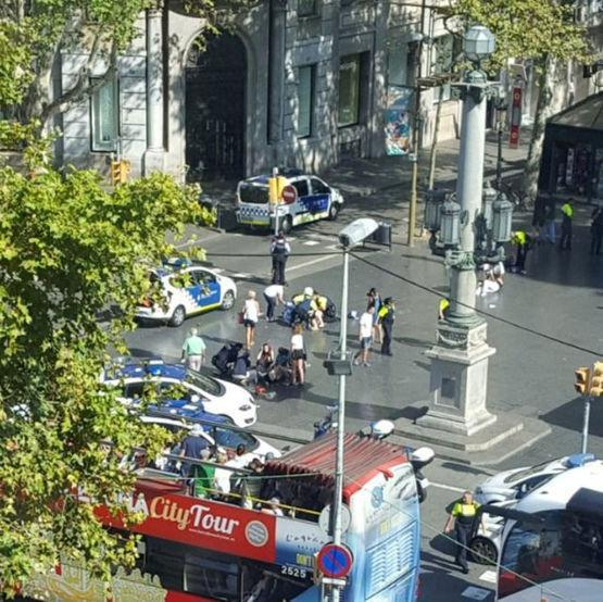 Police and emergency services attend to injured persons at the scene REUTERS