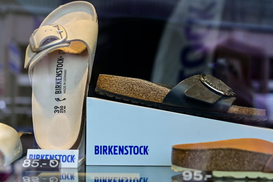 Sandals of the German sandals and shoes maker Birkenstock are pictured in a store window at the company's store in Berlin on February 26, 2021. - Germany's unabashedly frumpy but comfortable flat sandals Birkenstock stepped into the luxury leagues on February 26, 2021, with an LVMH-backed company and the French group's billionaire owner snapping up a majority stake in the iconic brand. (Photo by John MACDOUGALL / AFP) (Photo by JOHN MACDOUGALL/AFP via Getty Images)