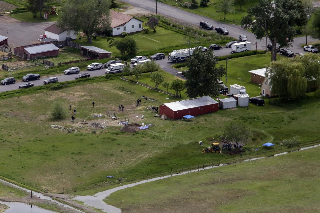 In this aerial photo, investigators search for human remains at Chad Daybell's residence on Tuesday, June 9, 2020, in Salem, Idaho. Authorities say they uncovered human remains at Daybell's home as they investigated the disappearance of his new wife's two children.