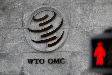 FILE PHOTO: A logo is pictured outside the World Trade Organization (WTO) headquarters next to a red traffic light in Geneva, Switzerland, October 2, 2018. REUTERS/Denis Balibouse/File Photo