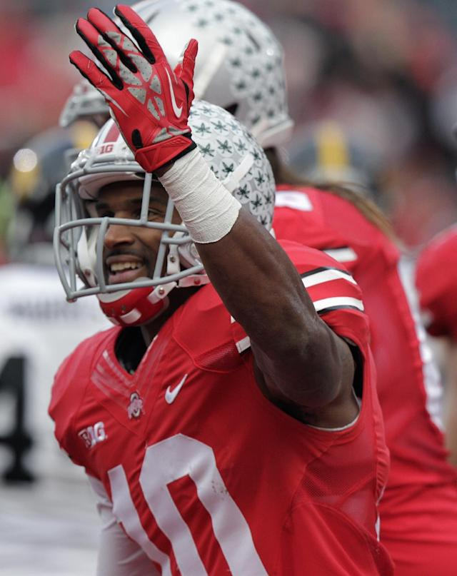 Ohio State wide receiver Corey Brown celebrates his touchdown against Iowa during the second quarter of an NCAA college football game Saturday, Oct. 19, 2013, in Columbus, Ohio. (AP Photo/Jay LaPrete)