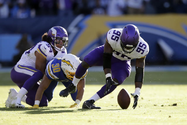 Minnesota Vikings defensive end Ifeadi Odenigbo, right, recovers a fumble before running it back for a touchdown during the first half of an NFL football game against the Los Angeles Chargers, Sunday, Dec. 15, 2019, in Carson, Calif. (AP Photo/Marcio Jose Sanchez)