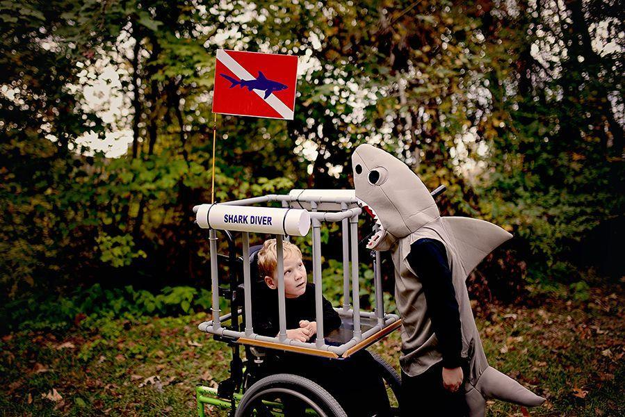 """<p>Just when you thought it was safe to go back in the water, here comes a shark diver with a sibling shark! (It sure beats another round of <a href=""""https://www.goodhousekeeping.com/holidays/halloween-ideas/g28367776/baby-shark-halloween-costume/"""" rel=""""nofollow noopener"""" target=""""_blank"""" data-ylk=""""slk:Baby Shark costumes"""" class=""""link rapid-noclick-resp"""">Baby Shark costumes</a>.)</p><p><a href=""""https://www.sarahhalstead.com/shark-diver-wheelchair-costume/"""" rel=""""nofollow noopener"""" target=""""_blank"""" data-ylk=""""slk:See more at Sarah Halstead »"""" class=""""link rapid-noclick-resp""""><em>See more at Sarah Halstead »</em></a></p>"""