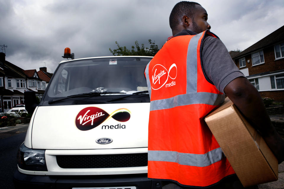 A Virgin Media employee delivering a digital tv reciever. (Photo by: Newscast/Universal Images Group via Getty Images)