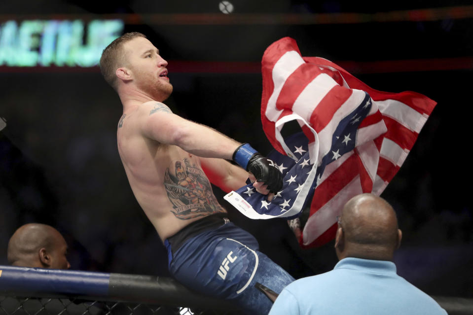 Justin Gaethje celebrates his win over Edson Barboza after their mixed martial arts bout at UFC Fight Night, Saturday, March 30, 2019, in Philadelphia. Gaethje won via first round TKO. (AP Photo/Gregory Payan)