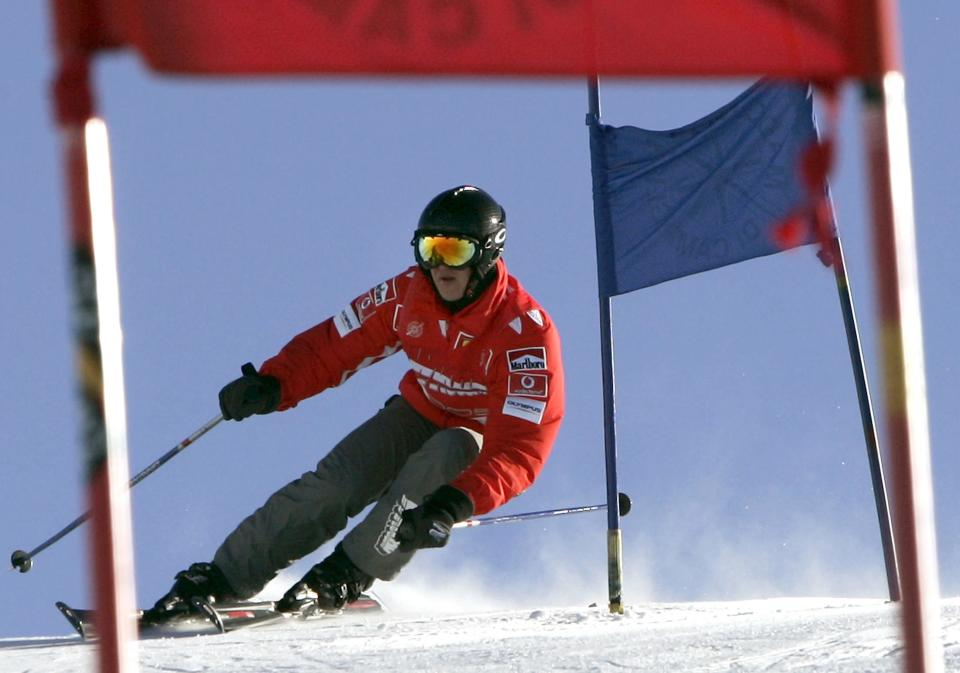 Former Formula One world champion Michael Schumacher skis downhill in the northern Italian resort of Madonna Di Campiglio in this January 14, 2005 file photo. Schumacher suffered a serious head injury while skiing in the French Alps resort of Meribel, French media reported on December 29, 2013. (REUTERS/Alessandro Bianchi)