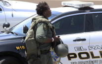 A law enforcement officer walks near the scene of a shooting at a shopping mall in El Paso, Texas, on Saturday, Aug. 3, 2019. Multiple people were killed and one person was in custody after a shooter went on a rampage at a shopping mall, police in the Texas border town of El Paso said. (AP Photo/Rudy Gutierrez)