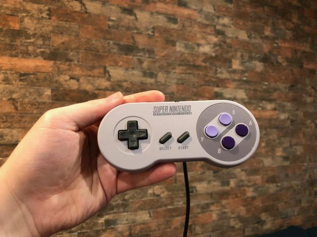 Nintendo not only made the SNES controllers full-size, the company also throws in a second one for two-player games.