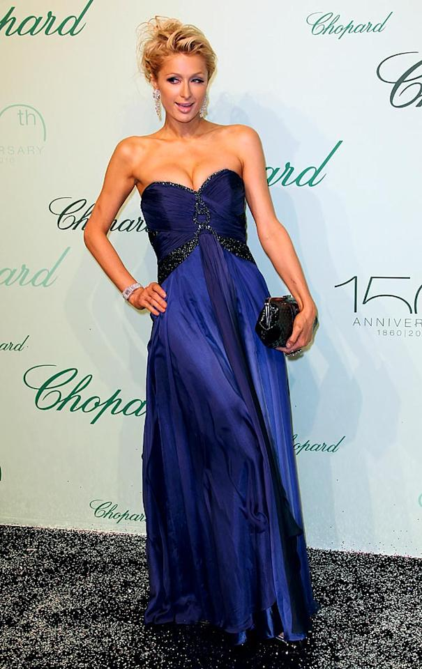 """It's been quite some time since Paris Hilton last appeared in our 2 Hot 2 Handle gallery, but she's back and better than ever thanks to the dress and 'do she rocked at Chopard's recent 150th anniversary party. She may be a ditzy diva, but she looks divine! Tony Barson/<a href=""""http://www.wireimage.com"""" target=""""new"""">WireImage.com</a> - May 17, 2010"""