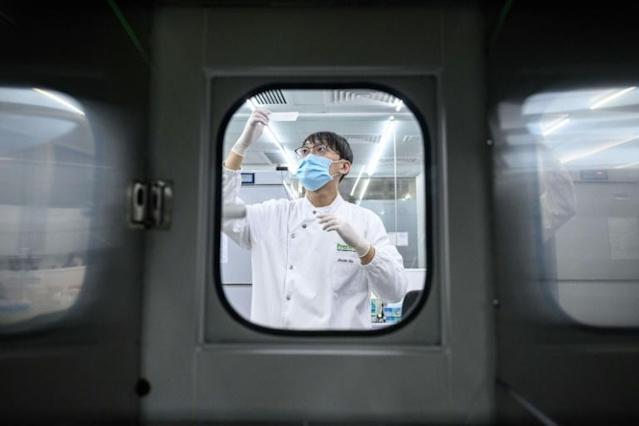 A Hong Kong firm landed the contract to test Premier League players and staff for the coronavirus (AFP Photo/Anthony WALLACE)