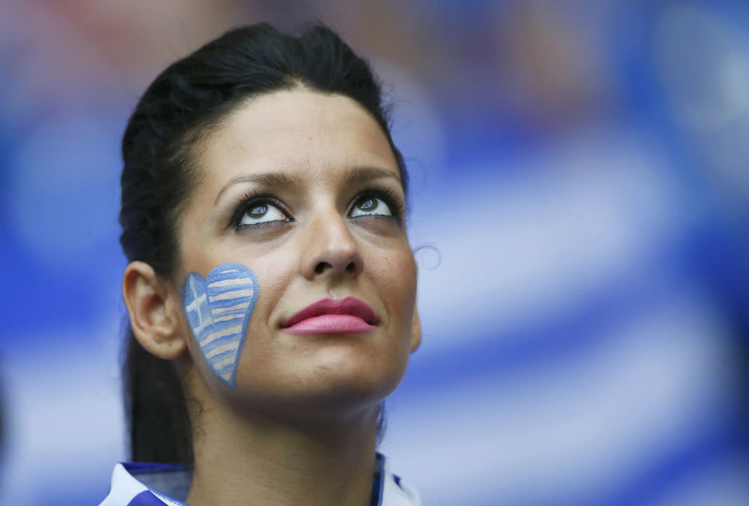 Greek soccer fan waits for the start of their Group A Euro 2012 soccer match against Russia at the National stadium in Warsaw, June 16, 2012.   REUTERS/Kai Pfaffenbach (POLAND  - Tags: SPORT SOCCER)