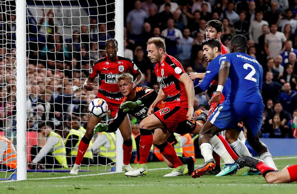Huddersfield Town survived several frantic goalmouth scrambles to draw Chelsea and officially avoid Premier League relegation. (Reuters)