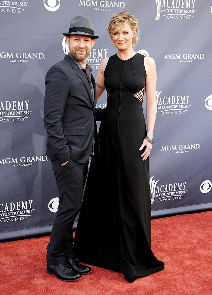 "Kristian Bush and Jennifer Nettles  Grade: B-   Sugarland's Kristian Bush stepped out in his signature suit and fedora, while Jennifer Nettles sported a black gown with interesting web detailing. Unfortunately, we couldn't take our eyes off her tacky wing-adorned heart tattoo! Denise Truscello/<a href=""http://www.wireimage.com"" target=""new"">WireImage.com</a> - March 3, 2011"