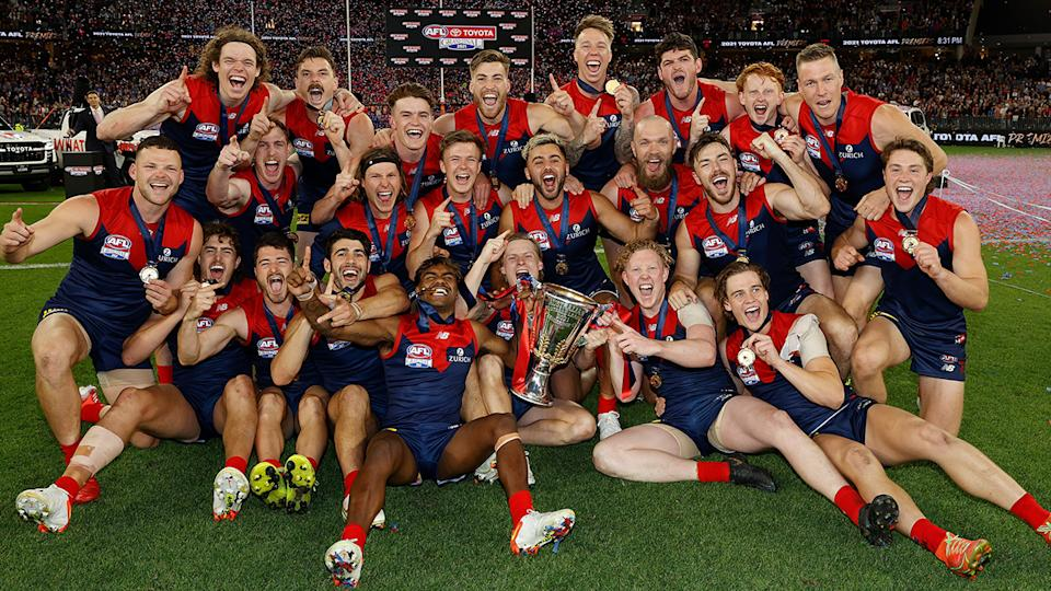 The Demons celebrate after defeating the Western Bulldogs to win the 2021 AFL grand final.
