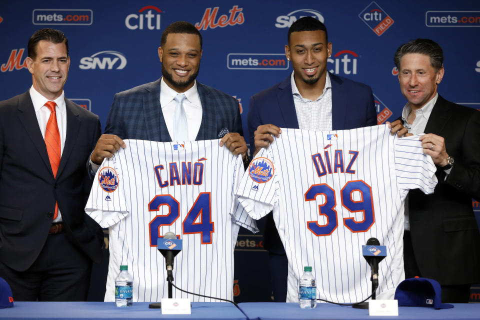 New York Mets' Robinson Cano, second left, and Edwin Daz, third left, pose with their new jerseys as they are introduced at a news conference at CitiField, in New York, Tuesday, Dec. 4, 2018.(AP Photo/Richard Drew)