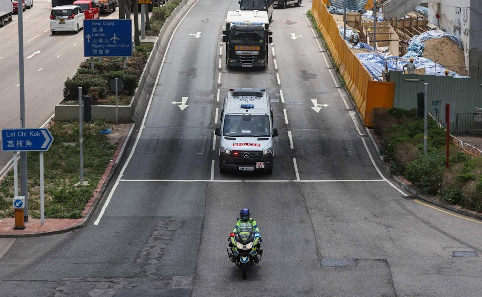A convoy of police vehicles brings activist Andy Li to West Kowloon Court on Wednesday. Photo: K.Y. Cheng