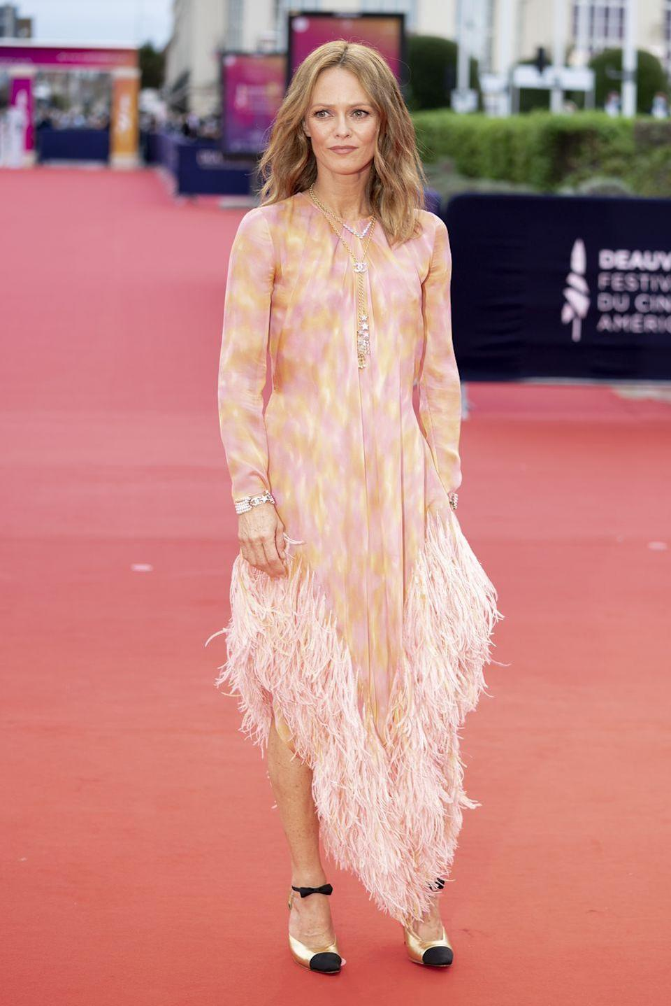 <p><strong>4 September </strong>Vanessa Paradis opted for a fun and feminine feathered Chanel look. </p>