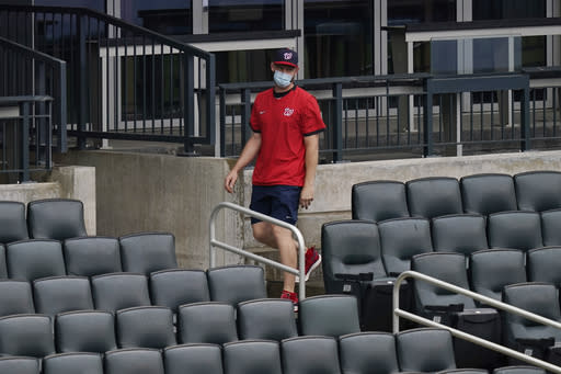 Washington Nationals pitcher Stephen Strasburg leaves the stands after being ejected for arguing balls and strikes during the third inning of a baseball game against the New York Mets at Citi Field, Thursday, Aug. 13, 2020, in New York. (AP Photo/Seth Wenig)